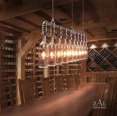 These DIY lights are very symmetrical. They have industrial feel to them because of the pipes that they are attached to. They match the shape of the wine bottles which are also in this room. The light colour is dim which goes well with the wood interior architecture of the room.