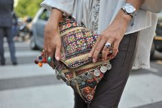 eclectic global styled clutch with coin detail