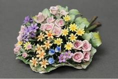 Refined Bouquet thousand-colors worked in fine Capodimonte porcelain. Each flower is reproduced in detail by the artist and it is then laid on an elegant bed made of leaves, which is also entirely woven by hand.        Dimensions cm. 15x20