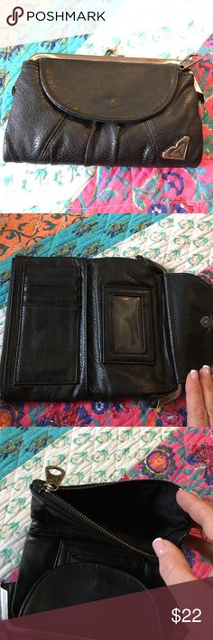 Large black wallet Roxy brand large black wallet. Change purse on one side. Zipper pocket on other. 5 card slots and one window pocket. Large flap pocket under card slots. Roxy Bags Wallets