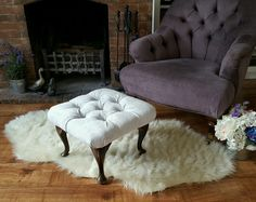 Grey deep button tufted footstool with fleur de lis buttons, now sold