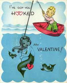 Vintage Mermaid Valentine - saw vintage cards hanging from a tree branch (like easter tree) and mounted on red chipboard with glitter. Super cute -- world market