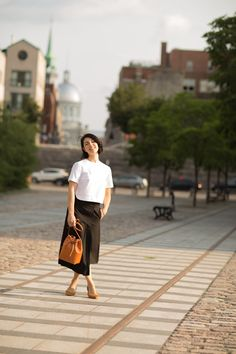 Casual Elegance. Yune Ho white crop top, Lemaire pleated black skirt, camello Mansur Gavriel bucket bag, Loeffler Randall pointed flats.