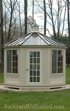 12' Ivory Vinyl Octagon Cabana with Cupola and Standing Seam Metal Roof http://www.backyardunlimited.com/cabanas.php
