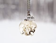 Dandelion wish necklace is absolutely perfect & a must have. Wear this to remind you of your new years resolutions.