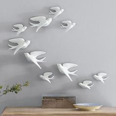 Create an instant work of art with our Birds of Flight wall hanging. Each member of this host of five sparrows is handcrafted in white ceramic with a matte finish.Handcrafted in white ceramicMatte finishEach bird is equipped with an integrated nail hole for hangingSet of five sparrows includes 3 small and 2 largeFeatured images show 2-3 sets displayed together