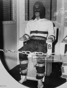 An American prisoner, sentenced to death, is strapped into a chair in the gas chamber. The black hood carries a Westinghouse Electric Company logo. (Photo by Weegee(Arthur Fellig)/