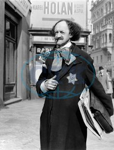 Painter Robert Guttmann with a Jewish star on his coat walking down one of the streets of Prague. September 1941.
