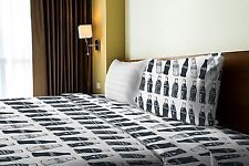 The Coca-Cola Company Bottles Twin Sheet Set including: 1 Flat Sheet, 1 Fitted S