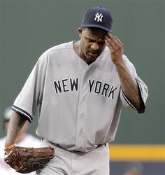 GAME 61: Tuesday, June 12, 2012 - New York Yankees starting pitcher CC Sabathia reacts after giving up a double to Atlanta Braves' Brian McCann in the first inning of a baseball game in Atlanta. (AP Photo/David Goldman)