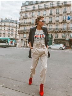 GUCCI Logo Graphic T-Shirt + Storets High-Waisted Paper-Bag Pants with Belt + Bright Red Sock Booties + Black Oversized Blazer via Hello Fashion Blog // Fashion Blogger, Style Blogger, Women's Outfit Ideas, Fashion Trends, Women's Fashion