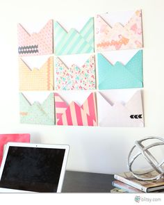 Create large envelopes as a colorful backdrop and great way to get organized! how cute is this for a cubicle