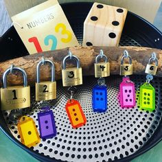 Numbers.... Kmart tray with PVC placemat, wooden book and dice (from Kris Kringle store) along with some padlocks! #ourkinder #kmart…