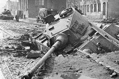 """bmashina: """" German tank PzKpfw VI Ausf.B """"Tiger II"""" from the composition of the 503rd SS heavy tank battalion who fell into the crater made by a bomb in the streets of Danzig. """""""