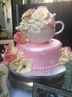 If this is not the perfect cake for a tea party themed bridal shower, I don't know what is! I would change the bottom a little--no polka dots, but this is so perfect!!!