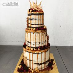 Three tiered salted caramel and chocolate wedding cake, semi naked finish. ~ talk about sweet tooth!! #opt2shop