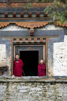 Royal Palace Monks Bhutan photograph by Ken Hayden