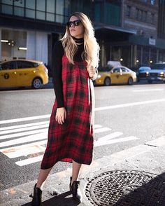 Loving how @_annaschuster styled this bold plaid slip dress for fall