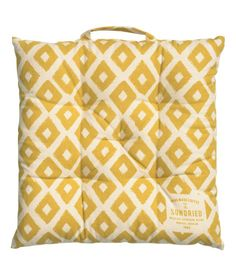 Check this out! Seat cushion in woven organic cotton fabric with a printed pattern. Handle at one side and small printed text detail in one corner. Polyester fill. Thickness 1 1/2 in. - Visit hm.com to see more.