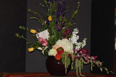 Modern fun designed by The Little Shop of Flowers in Stillwater, ok for information call 405-372-1200