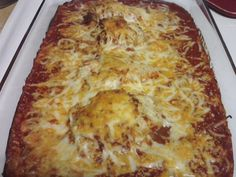 Chicken Parmigiana: 1 egg, bread crumbs, 2 chicken breasts, jar of spaghetti sauce (I use my homemade marinara sauce), mozzarella cheese, parmesan cheese.  Coat breasts in egg and bread crumbs. Bake approximately 20 minutes at 350.  Place half jar of sauce in bottom of casserole dish, place chicken on top of sauce, drizzle more sauce on top of chicken and cover entire dish with mozzarella and parmesan cheese.  Bake at 350 for 20 minutes. Serve with your choice of noodles and salad…