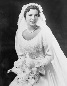 In bridal array here is the former Miss Ethel Skakel, of Greenwich, the bride of Robert F. Kennedy, son of Joseph P. Kennedy, former U.S. Ambassador to Great Britain, and Mrs. Kennedy, of Hyannis, Massachusetts, and West Palm Beach, Florida. The bride is the daughter of Mr. and Mrs. George Skakel. She was graduated from Manhattanville College last June and is now doing graduate work at Columbia. Kennedy served in the U.S. navy during the war.Ethel's wedding dress and bridal party gowns wer