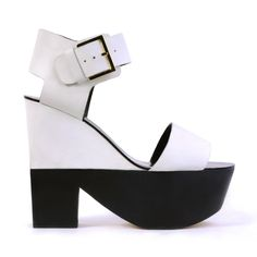 Colour- block me baby! Check out this buckled beauty, the perfect wedge of the season. Wrapped in smooth leather teamed with a hand crafted wood base, the wedge height measures 14cm and platform is 6cm.