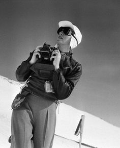 American photographer Toni Frissell on the ski slopes with her camera, 1944