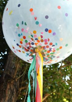 Confetti Birthday Party | confetti filled balloon w streamers.