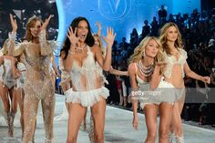 Models Karlie Kloss, Adriana Lima, Candice Swanepoel, and Behati Prinsloo walk the runway at the 2013 Victoria's Secret Fashion Show at Lexington Avenue Armory on November 13, 2013 in New York City.