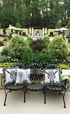 An eye-catching addition to any outdoor setting, this unique bistro style seating features a mesmerizing radial pattern and whimsically curled arms.  | Ed Castro for Atlanta Symphony Orchestra Show House 2015