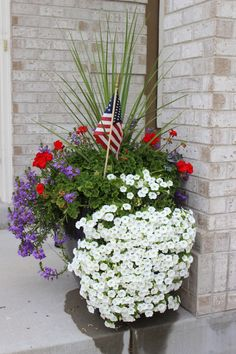 4th of july hanging planters | Pretty planter, fourth of july planter, planter ideas.