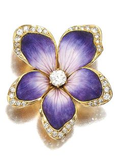 Lovely regal violet floral brooch decorated with enamel & highlighted with diamonds!circa 1900