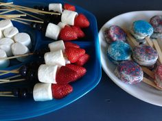 Memorial Day/Fourth of July treats that kids will love to make...and eat!:) Chocolate covered Oreos with sprinkles and Strawberry(red), marshmallow(white), and blueberries(blue) kabobs...