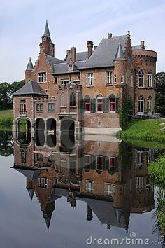 Middle ages castle reflected in the water.