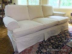 This natural denim slipcover gives a formal Sherrill sofa a casual, versatile new look.