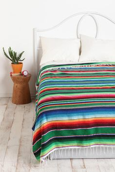 I love having a sarape on my bed. Real ones are beautiful, longlasting and comfy. Can be used as a great wall decor or a carpet too.