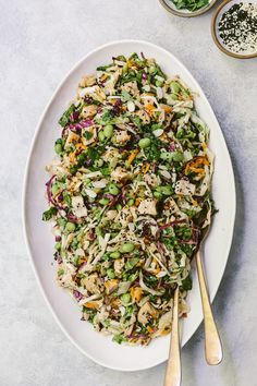 An Asian-Style chicken salad recipe made with green & red cabbage and lettuce and flavored with an almond butter dressing. The best way to use left over chicken.