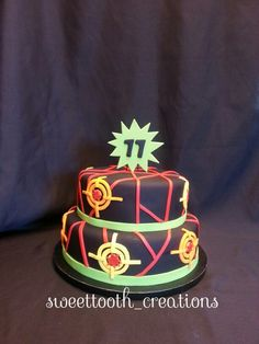 Laser Tag theme cake. Follow sweettooth_creation on Instagram for more of there work.
