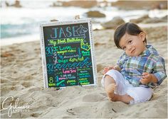 Family Portrait - first birthday cake smash at the beach! - Newport Beach Photographer bench, CDM, ocean, rocks, sand, 1st birthday, happy first birthday, white and blue, one year old photo, Orange County, sign, announcement, invite, party, cake smash, baby boy, toddler, family, small family, sunset, corona del mar, happy, laughing, cute, GilmoreStudios.com