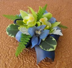 Green Orchid and blue Delphinium Corsage