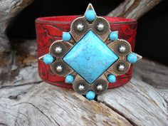 Red embossed leather bracelet/cuff featuring ornate 2 inch turquoise concho. $28.00, via Etsy.