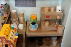 Play cafe made from cardboard. Love the espresso machine! Maybe this will be my summer project and put it in our dramatic play area this fall/winter!
