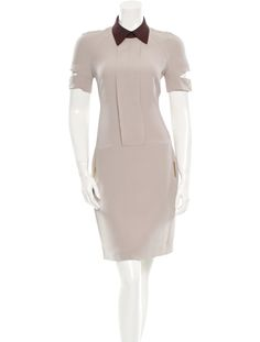 Grey Victoria Beckham dress with short sleeves featuring snap buttons and cutout details, fabric accents at front, two pockets at hips, plum collar and exposed zip closure at back. Includes tags.