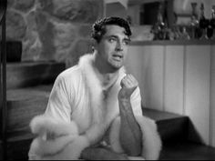 "Cary Grant - Bringing Up Baby 1938 by Diogioscuro, via Flickr // Tricked into Katharine Hepburn's lingerie... ""Why are you dressed like that""? ""Because I just went GAY all of a sudden""! -- especially cute because of the nod to Cary's real life outside hetero movie land"