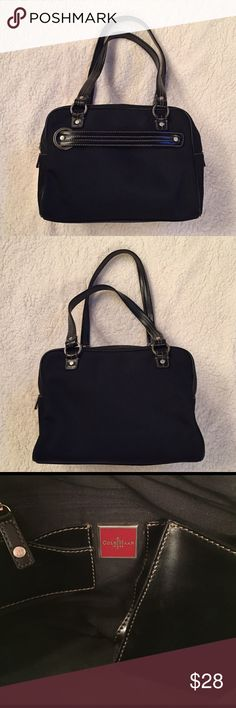 Cole Haan Purse Black canvas bag with leather straps and detail.  Black interior with leather phone and credit card/ID compartment.  Zipper section in front.  Silver hardware. Great condition!! Taking offers if interested. Cole Haan Bags