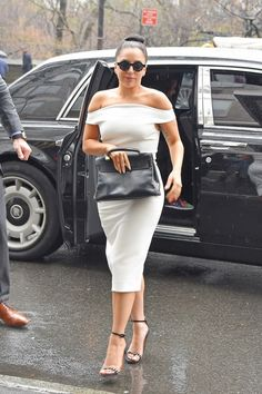 Lady Gaga impresses with a chic, off-the-shoulder white dress, ladylike bun, and studded sandals