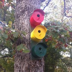 Bird house made out of old coffee cans-clever!