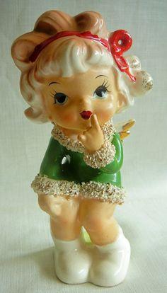 Lefton Winter Angel, green dress, red hair ribbon, golden wings. Spaghetti trim.