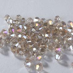 Pas cher Top qualité qualité 4mm100pcs cristal toupie perles perles de cristal perles en vrac autriche bijoux accessoires argent champagne AB, Acheter  Perles de qualité directement des fournisseurs de Chine:top quality 3mm100pcs Crystal 5301 bicone Beads Austria Crystal Beads Loose Beads jewelry accessories u pick(1-18)USD 0.